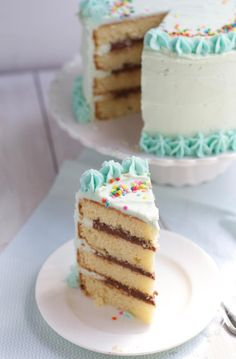 Classic Yellow Layer Cake with Fudge Filling  via The Baker Chick