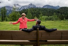 June 8, 2015: We were at the G7 Summit in Krün, Germany. Chancellor Angela Merkel asked the leaders and outreach guests to make their way to a bench for a group photograph. The President happened to sit down first, followed closely by the Chancellor. I only had time to make a couple of frames before the background was cluttered with other people.