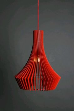 Купить или заказать Светильник из фанеры ДЕКАНТЕР в интернет-магазине на Ярмарке Мастеров. Светильник из фанеры ДЕКАНТЕР. Состоит из 45 вертикальных деталей. Такое неэкономное количество позволяет быть светильнику не только заметным своим размером, но и грамотно прикрывать яркий свет лампы. Вариант светильника в цвете превращает его в некий арт-объект, интерьерную форму, выходя за пределы обычного средства для освещения. Цвет может быть любым.