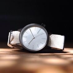 http://fancy.com/things/608318938173935198/Vintage-White-Magnus-Watch-by-Komono?ref=ffemail