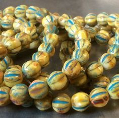 6mm melon beads in Ivory Picasso with turquoise wash.