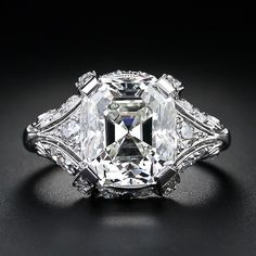 Who wouldn't say 'YES?' 5.32 Carat Asscher Cut Diamond Ring, SI-1/K color. 40 single cut diamonds tcw of 1.0 carats. Platinum. Circa 1920s-30s