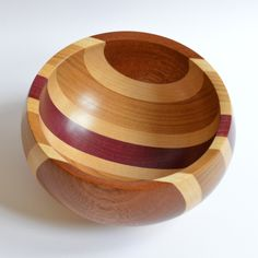 This unusual bowl has some beautiful natural coloured woods that compliment each other so well; made from Elm, Sapele, Maple and Purple Heart wood. Each segment of the bowl has been re-sawn to size, planed and then given a quick sanding before being gl. Wood Turning Lathe, Wood Turning Projects, Wood Lathe, Router Wood, Cnc Router, Lathe Projects, Wood Projects, Learn Woodworking, Woodworking Projects