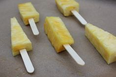 "Frozen Pineapple Pops -- Pineapple, on a stick and frozen Site says ""When pineapple freezes it actually has a creamy taste that melts in your mouth. Not to mention, they make a great low calorie snack for adults and a tasty teething treat for a toddler!"" Must try this!"