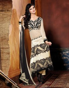Lavish Cream & Black Embroidered Salwar Kameez Design No :- 18559 Product :- Unstitched Salwar Kameez Size :- Max 40 Fabric :- Pure Georgette, Velvet Work :- Resham, Jari, Embroidery Stitching Charges :- र 400 Price :- र 6145  For Sales Queries :- sales@manjaree.in OR call on 0261-3131669  For More Information :- http://manjaree.in/  Follow Our Blog :- http://manjareefashion.blogspot.in/