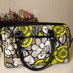 Vera Bradley Mini Loft Duffel Very good condition Mini Loft Duffel in Citron   With black trim Double handles front slip pocket  back 2 magnetic slip pockets  double zipper closure inner zippered pocket and 2 slip pockets metal feet on bottom for stability is slight tarnish tips of feet see pic light scratches on bottom No smoking or pets Vera Bradley Bags Satchels