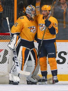 NASHVILLE, TN - JANUARY 09: Roman Josi #59 of the Nashville Predators congratulates teammate goalie Pekka Rinne #35 after a 2-1 victory over the Edmonton Oilers at Bridgestone Arena on January 9, 2018 in Nashville, Tennessee. (Photo by Frederick Breedon/Getty Images)