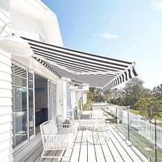 Luxaflex Ventura Folding Arm Awning, Cottage Deck - Three Birds Renovations House Bonnie's Dream Home Deck Awnings, Three Birds Renovations, Small Terrace, Small Patio, Outdoor Blinds, Striped Cushions, Beach Shack, Outdoor Living, Outdoor Decor