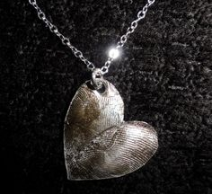 Couples pendant: husband and wife, girlfriend & boyfriend, best friends... Your fingerprint on one side, theirs on the other.
