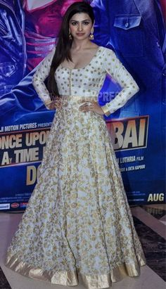 Prachi Desai, who has worked in Ekta Kapoor's Once Upon A Time In Mumbaai, was pretty in a white SVA floor-length anarkali. Prachi had made her small screen debut as Bani in Ekta Kapoor's hit TV serial Kasamh Se. Indian Gowns, Indian Attire, Pakistani Dresses, Indian Wear, Indian Outfits, Anarkali Gown, Lehenga Choli, White Anarkali, Churidar