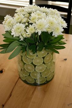 Easy but Dramatic Centerpiece - Cosmo Cricket-definitely doing this! Fruit Centerpieces, Wedding Centerpieces, Wedding Decorations, Table Decorations, Lime Centerpiece, Beautiful Flower Arrangements, Floral Arrangements, Beautiful Flowers, Exotic Flowers