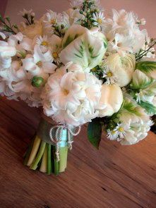 Spring counrtry Bridal hand tied bouquet, hyacinths, parrot tulips, ranunculas and dasies. www.enchantedflorals.co.uk
