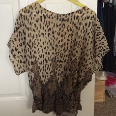 Gorgeous leopard Print Blouse Dolman style top in great condition!! So cute and sexy! Enjoy! American Rag Tops Blouses
