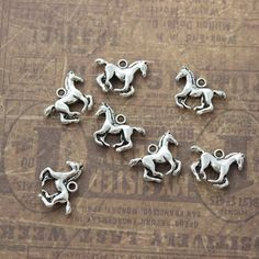 10 Running Horse Charms Horse Pendants Antiqued Silver Double Sided 3D 18 x 15mm Perfect parts for craft making or jewelry decoration.  Quantity: 10 pieces Size: 18 mm X 15 mm Color: Antiqued Silver Material: Metal Alloy,Nickel free  If you would like to order larger amount,please convo me for pricing.