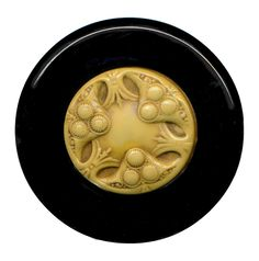 "Button--Vintage Art Deco Triskelion Ivoroid Fruit & Leaf on Black Celluloid TT   This is an extra large attraction Art Deco period button of ivoroid celluloid on a black tight-top  celluloid with Japanned tin back. It is a beautiful design of stylized fruit & foliage and measures 2 & 5/8"" in excellent condition with a strong brass loop shank.  SOLD $65.00"