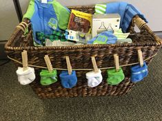 Baby shower basket for a coworker, It was a hit! I filled the bottom with diapers, wipes, and burping clothes. #babygiftbaskets