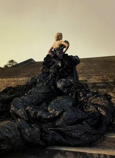 Kirsten Dunst by Annie Leibovitz in a Dior Couture by John Galliano dress of black aluminum foil covered in organza