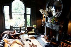Modern and Moody: Dark Feminine Love the black fireplace mantel and convex mirror!