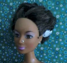 "Old Marina doll from mattel, gave her a nosepiercing and a ""Billie Holiday"" look"