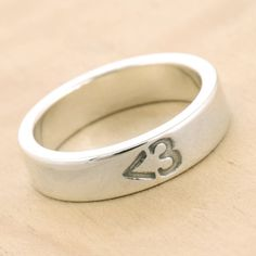 Heart Emoticon Ring, $55 | 34 Unconventional Wedding Band Options For Men