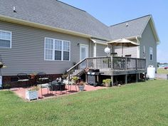 Exterior amenities include a low maintenance vinyl siding, attached double garage, and rear deck with paver grilling patio that overlooks a spacious back yard. 202 Spoonbill Dr., Goldsboro, NC Presented by Jeri Lynn Coker, Realtor goldsbororealestatefinder.com