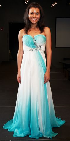 """""""The Goddess""""—This floor-length strapless gown will call to mind the ethereal beauty of Aphrodite emerging from the sea. Stunning seafoam green blends into sheer white in the full flowing skirt. The ruched sweetheart neckline is amazingly flattering and the stunning jewel detail on the bodice will light up the night. Retail Price $1,200 This item was donated by Allure for the live 2012 auction."""