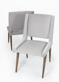 For the Mid Century modern home, these dining chairs are the perfect accent for your dining room. Upholstered in silver grey velvet with solid hand- oiled walnut legs and a sleek cut out at the bottom