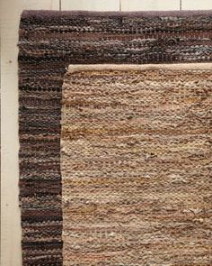 more rustic contemporary 8x11 lighter one.  Eileen Fisher Recycled-Leather Rug