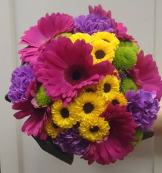 Vivid colours included, Gerbera, Vyking Dark and Feeling Green Dark Chrysanthes.