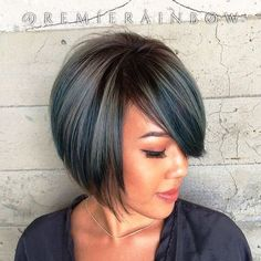 chin-length layered bob with side bangs                              …