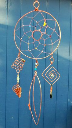 Crystal & Reclaimed Copper Dreamcatcher Sculpture Ornament Rescued Redwood Recycled Glass Up-cycled Beads. $1,250.00, via Etsy.