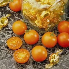 Sun Sugar - very sweet, yet capturing tangy true tomato flavor. The deep golden-yellow 1/2 ounce fruits are very crack resistant. 62 DTM