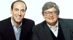 "Eugene Kal ""Gene"" Siskel (January 26, 1946 – February 20, 1999) was an American film critic and journalist for the Chicago Tribune. Along with colleague Roger Ebert, he hosted a series of popular review shows on television from 1975 to 1999. Roger Joseph Ebert (June 18, 1942 – April 4, 2013) was an American film critic, journalist, screenwriter and author. They co-hosted the PBS show Sneak Previews, and several At the Movies type programs. They created and trademarked the phrase ""Two Thumbs…"