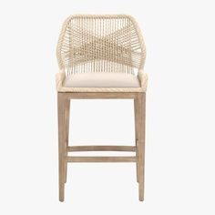 Our Luca Sand Woven Bar Stool features an intricately woven rope design, adding flair to any dining or casual living setting.