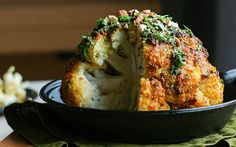 <p>For a stunning centerpiece that looks as amazing as it tastes, you have to try this roasted whole cauliflower.</p>