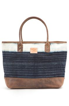 Free shipping and returns on Will Leather Goods 'Indigo Batik' Cotton Canvas Tote at Nordstrom.com. Modern functionality and a traditional global art form combine in this rugged tote crafted from repurposed indigo-dyed batik fabric. A reinforced leather base and double-riveted handles ensure the carryall is as strong as it is style savvy.