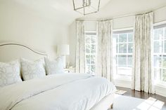 White and ivory bedroom features an ivory nailhead camelback headboard on king bed dressed in white and gray bedding placed next to an ivory nightstand adorned with nickel ring pulls and a white glass column lamp. Bedding Master Bedroom, King Bedroom, Bedroom Decor, Bedroom Ideas, Ivory Bedroom Furniture, Bedroom 2017, Master Bedrooms, Grey And White Bedding, White Bedroom