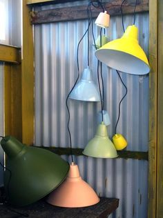 inexpensive Foto lamp from IKEA. spray painted in fun colors. great way to get industrial color into an office.