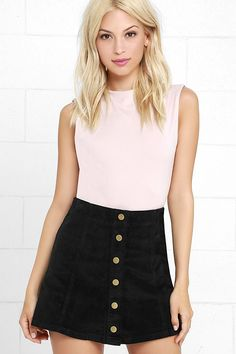 Corduroy is back and better than ever, and pieces like the White Crow Austin Black Corduroy Mini Skirt have us swooning! This lightweight A-line skirt has a high-waisted fit and front snap button placket.