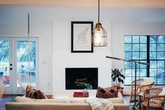 Natalie and Bobby's small town home in Texas Hill Country is bright, open, and very inviting. An excellent mix of old and new along with plants and other natural elements, have lent to the perfect bohemian mix. Shop their style for a tranquil space of your own.