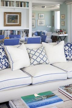 blue sofa accented with crisp white pillows Coastal Living Rooms, Home Living Room, Living Spaces, White Couches, White Pillows, Home Modern, Blue Rooms, White Decor, Family Room