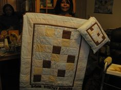 A baby boy quilt with matching pillow