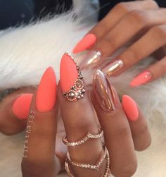 One nail on left and one nail on right hand in a metallic color with shiny rhinestones in the same shade. Other nails are mat in a gentle color that gives a seductive touch of glamor to your look.