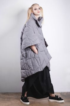 Quilted cape of waterproof fabric