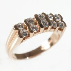 A distinctly different eternity ring set with double round brilliant cut diamonds in a half hoop eternity setting in 18ct rose gold. The ring is set with ten diamonds with a total weight of 1.0ct.