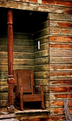A tiny porch corner.....This old chair...or rocker..awesome...love the patina on the old wood and post...