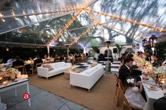 clear top tent, black and white dance floor, lounge, family style seating, white green and cream color palette