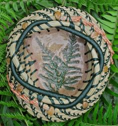 "Unique natural brown and green pine needle basket with Czech topaz leaf glass beads and a green fern pottery base entitled 'Woodland Ferns""."