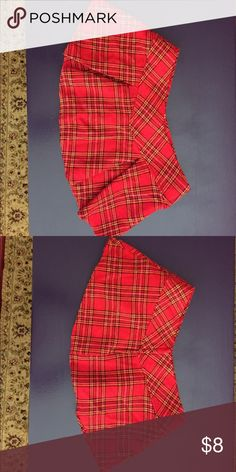 Adorable little red plaid winter skirt! Red plaid little skirt. Great with tights and black boots. Waist: 15 inches across Length: 10 inches Skirts Mini