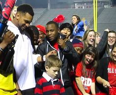 Young Rebel fan feeds Moncrief a helping of his breakdancing skills at the Vaught Video by Adam Brown. Text by Tad Wilkes. Every Rebel fan..
